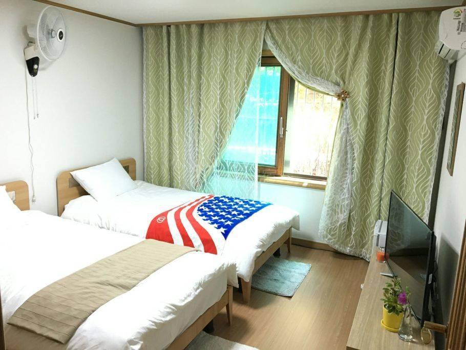 开心小屋1 ( 两张床 ) 位于首尔江南区